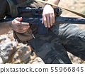 Man with sniper rifle. Hands close up. Middle eastern military conflict. 55966845