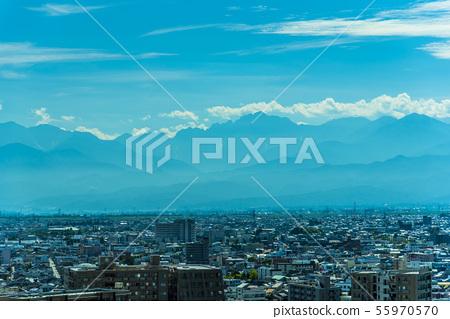 Toyama city and Tateyama mountain range 55970570