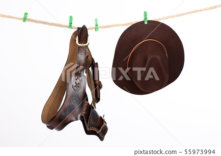Cowboy Hat and Belt On A Clothesline 55973994