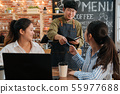 smiling waiter taking credit card from customer 55977688