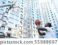 African Man Throwing Ball to Hoop 55988697