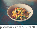 Delicious fruits salad in plate on table close-up 55989703