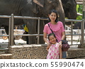Mother and little daughter in a zoo 55990474