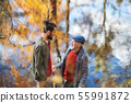 High angle view of senior father and his son standing in nature, talking. 55991872