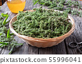 Nettle seeds collected in a basket 55996041