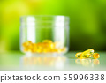 Vitamins supplements, fish oil in yellow capsules omega 3. 55996338