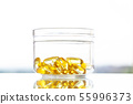 Vitamins supplements, fish oil in yellow capsules omega 3. 55996373
