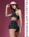 beautiful athletic slim woman in shorts and a pink cap 55997391
