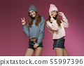 beautiful woman in pink hat and stylish glasses 55997396