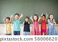 Multi-ethnic group of school children standing in 56006620