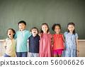 Multi-ethnic group of school children standing in 56006626