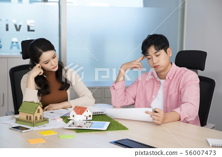 Office life concept, two asian business partners working in office 369 56007473