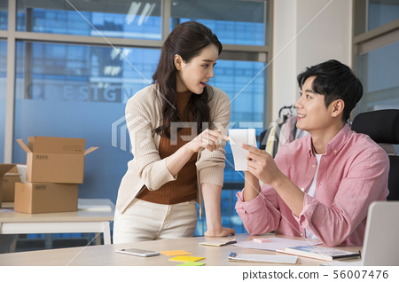 Office life concept, two asian business partners working in office 452 56007476
