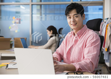 Office life concept, two asian business partners working in office 415 56007481