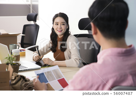 Office life concept, two asian business partners working in office 414 56007487