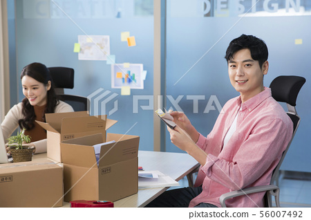 Office life concept, two asian business partners working in office 399 56007492