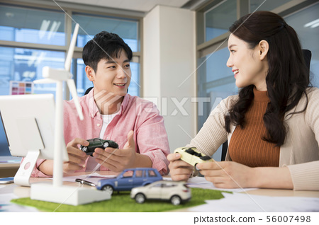 Office life concept, two asian business partners working in office 435 56007498