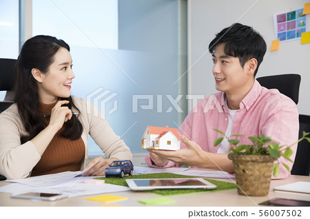 Office life concept, two asian business partners working in office 405 56007502