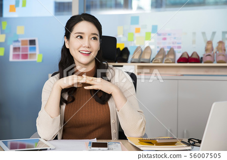 Office life concept, two asian business partners working in office 389 56007505