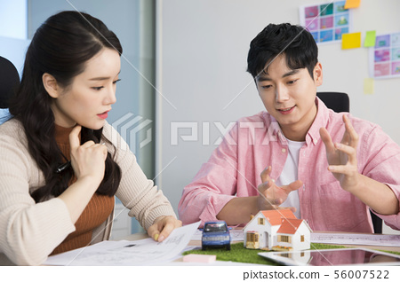 Office life concept, two asian business partners working in office 382 56007522