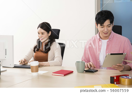 Office life concept, two asian business partners working in office 359 56007559