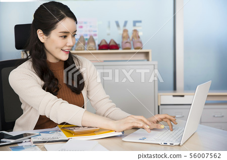 Office life concept, two asian business partners working in office 368 56007562