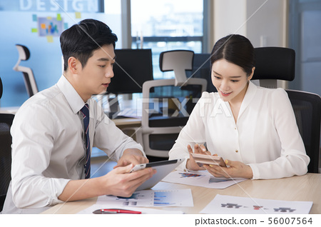 Office life concept, two asian business partners working in office 273 56007564