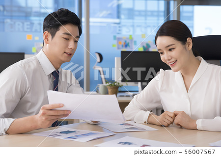 Office life concept, two asian business partners working in office 271 56007567