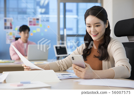 Office life concept, two asian business partners working in office 312 56007575