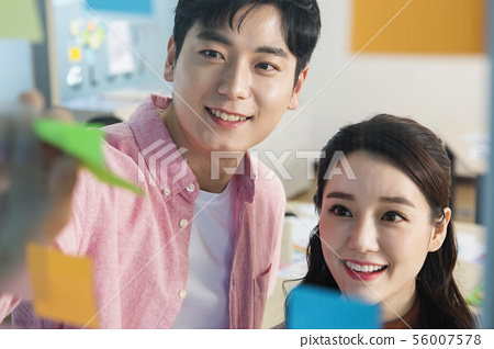Office life concept, two asian business partners working in office 345 56007578