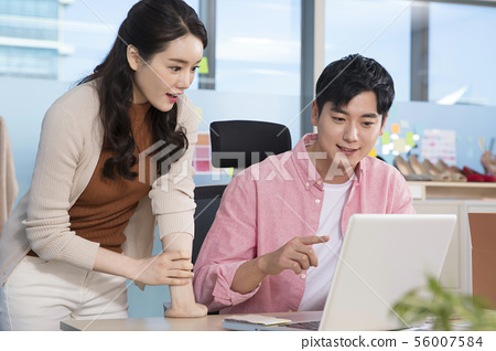 Office life concept, two asian business partners working in office 409 56007584