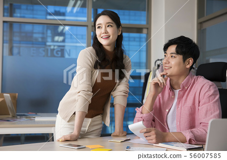 Office life concept, two asian business partners working in office 411 56007585