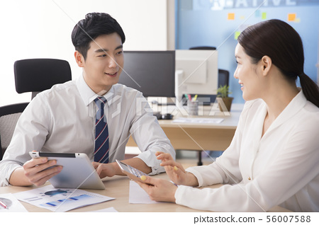 Office life concept, two asian business partners working in office 261 56007588