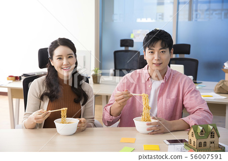 Office life concept, two asian business partners working in office 400 56007591