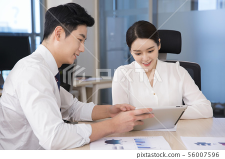 Office life concept, two asian business partners working in office 260 56007596