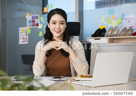 Office life concept, two asian business partners working in office 397 56007599