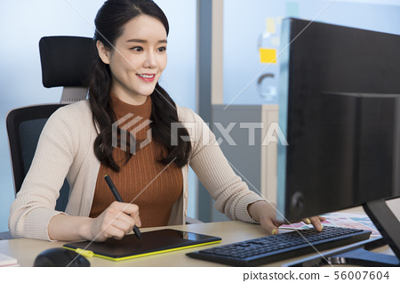 Office life concept, two asian business partners working in office 323 56007604