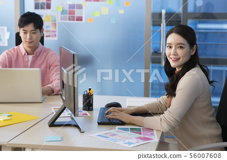 Office life concept, two asian business partners working in office 322 56007608
