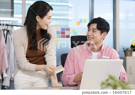 Office life concept, two asian business partners working in office 387 56007617