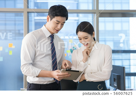 Office life concept, two asian business partners working in office 208 56007625