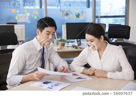 Office life concept, two asian business partners working in office 254 56007637