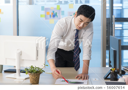 Office life concept, two asian business partners working in office 203 56007654