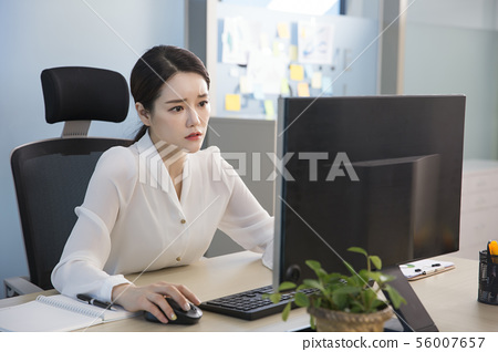 Office life concept, two asian business partners working in office 239 56007657
