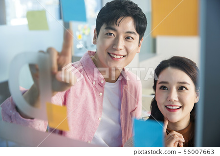Office life concept, two asian business partners working in office 287 56007663