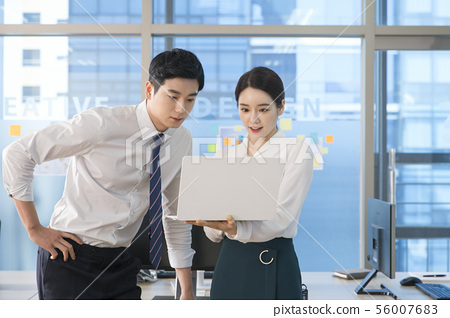 Office life concept, two asian business partners working in office 190 56007683