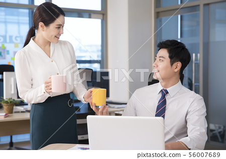 Office life concept, two asian business partners working in office 270 56007689