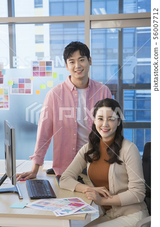 Office life concept, two asian business partners working in office 274 56007712