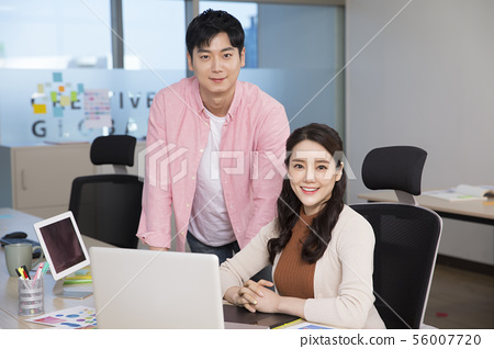 Office life concept, two asian business partners working in office 291 56007720