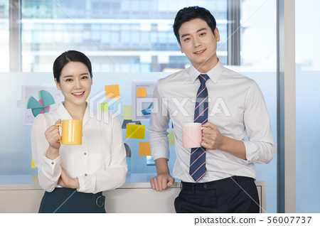 Office life concept, two asian business partners working in office 193 56007737
