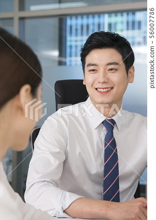 Office life concept, two asian business partners working in office 154 56007786